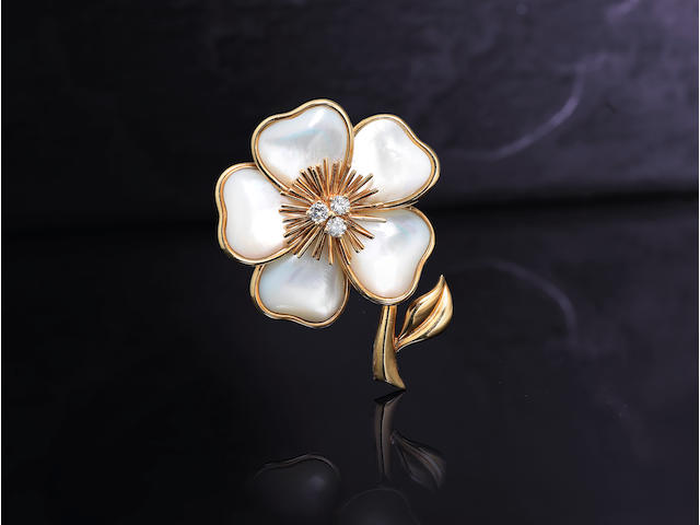 A diamond and mother-of-pearl 'Rose de Noël' brooch, by Van Cleef & Arpels,