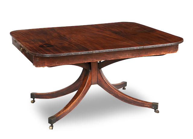 A Regency mahogany extending Pocock's patent dining table