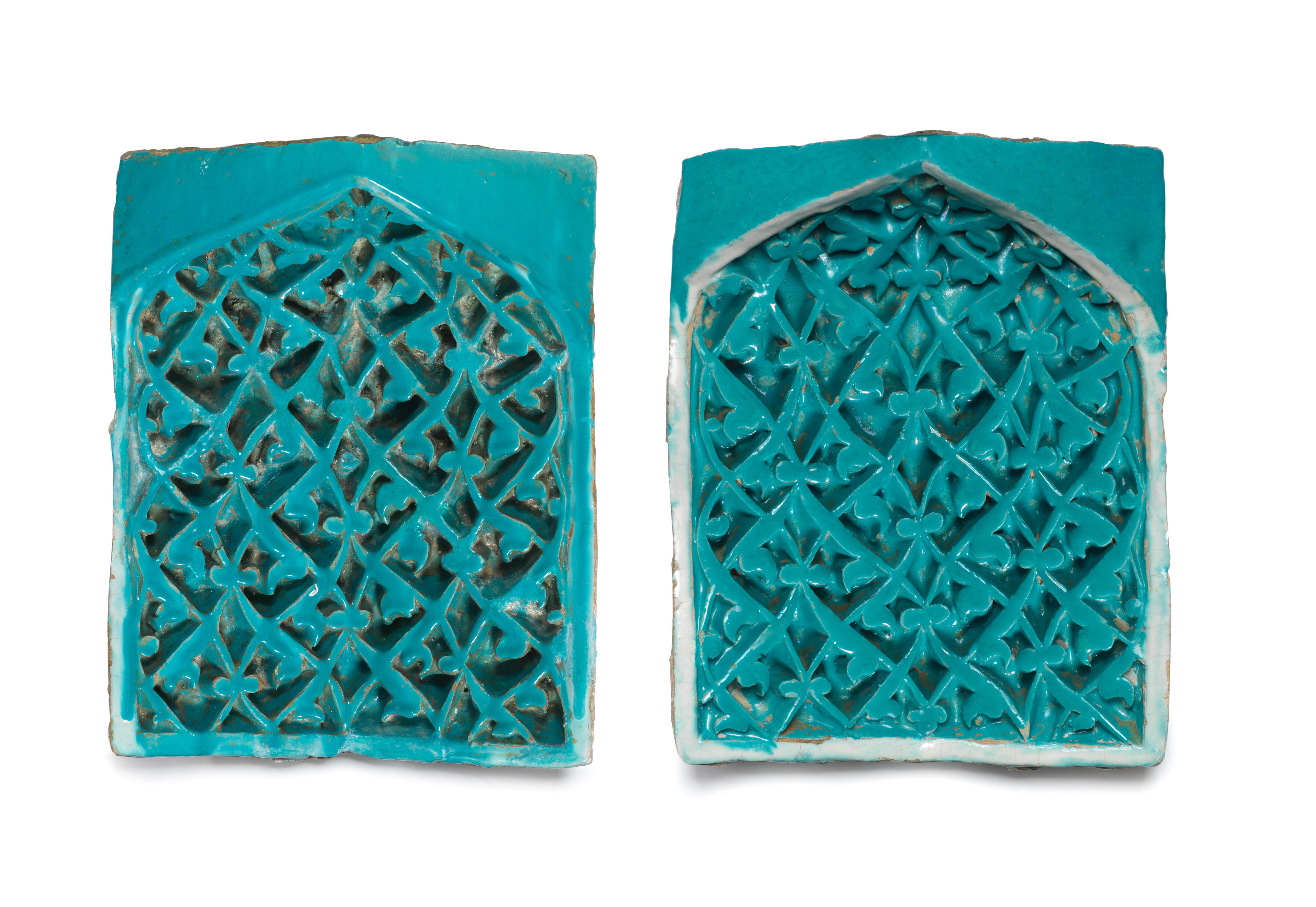 A pair of Timurid moulded pottery squinch tiles (muqarnas)