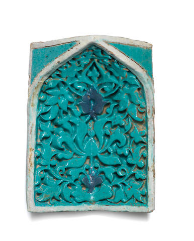 A Timurid moulded pottery squinch tile (muqarna) Persia, second half of the 14th Century