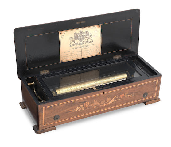 A 19th century walnut and marquetry cased cylinder music box bearing label inscribed Lith. A. HAAS Geneve, Guitare Tremolo, 1721