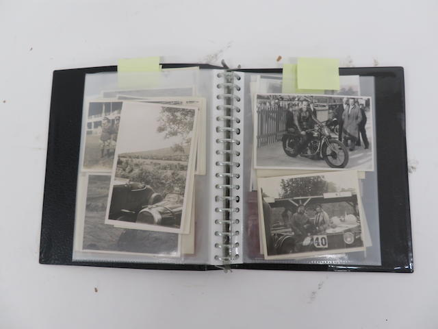 A display album including approximately 59 photographs of Stanley Woods throughout the years  ((Qty))