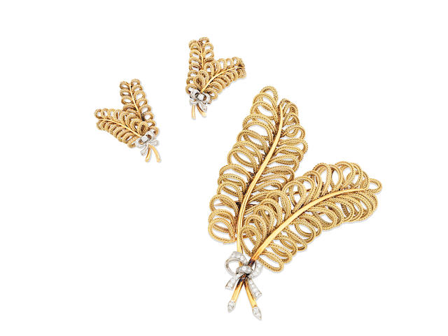 A diamond feather brooch and earclip suite, (2)