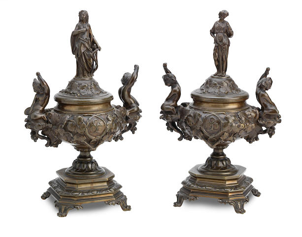 A pair of French late 19th Century bronze pedestal urns with covers (2)