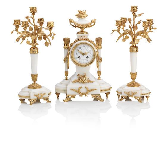 A late 20th Century gilt metal mounted white marble mantel clock garniture