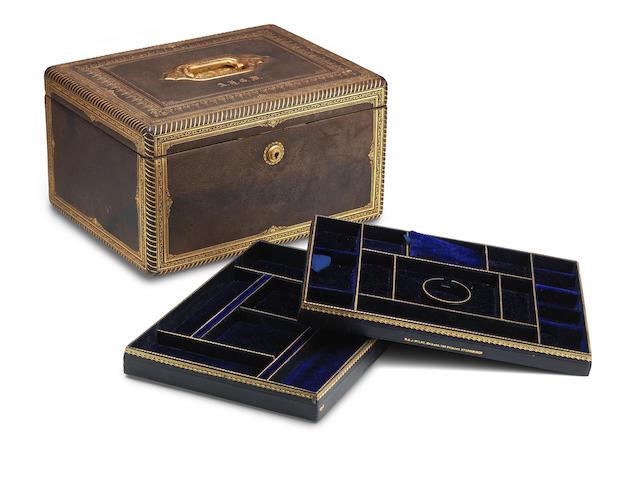 A 19th century tooled leather jewellery box  Stamped 'W & J Milne, makers, 126 Princes St, Edinburgh'