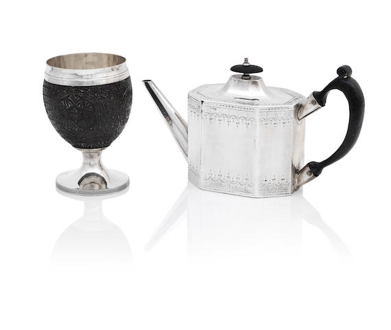 A George III silver-mounted coconut cup, and a George III silver teapot by Phipps & Robinson, London 1793, and I.H, London 1787 respectively  (2)