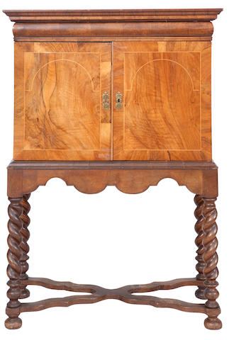 An 18th century and later walnut cabinet-on-stand
