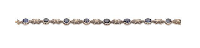A sapphire line bracelet, by Mario Buccellati,