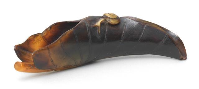 A buffalo-horn netsuke of a snail on a taro leaf Early 19th century