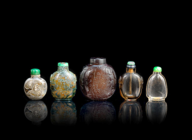 A group of five agate and rock crystal snuff bottles 19th century (9)