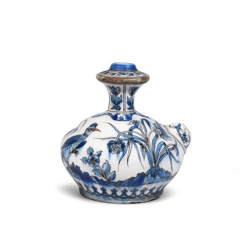 A Safavid style underglaze-painted pottery kendi Qajar Persia, 19th Century