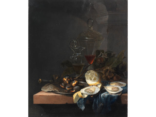 Circle of Jacob van Walscapelle (Dordrecht 1644-1727 Amsterdam) Oysters, chestnuts, glasses of wine and a peeled lemon on a cloth draped table-top unframed