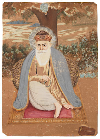 Guru Nanak seated against a bolster at the foot of a tree North India, late 19th/ early 20th Century