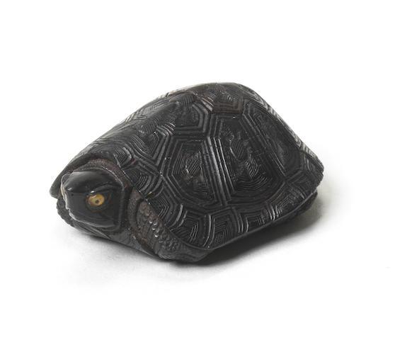An ebony netsuke of a tortoise