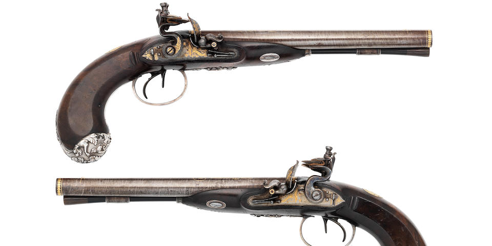 A Fine And Exceptionally Rare Pair Of Gold-Inlaid 28-Bore Flintlock Silver-Mounted D.B. Pistols Made For The Nawwab Of Oudh (2)
