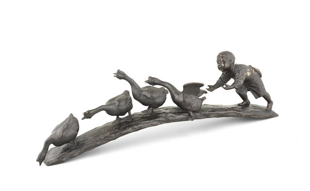 A Tokyo School bronze okimono of a boy and four geese By Izumi Seijo (1865-1937) for the Kaneda Company, Meiji era (1868-1912), late 19th/early 20th century