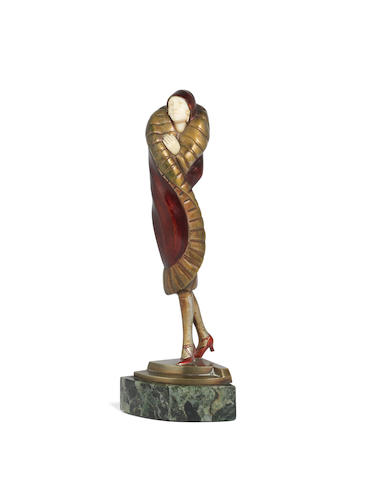 Richard Lange (German, 1879-1944) An Art Deco Patinated Bronze and Carved Ivory Study of a Stylish Female Figure, circa 1925