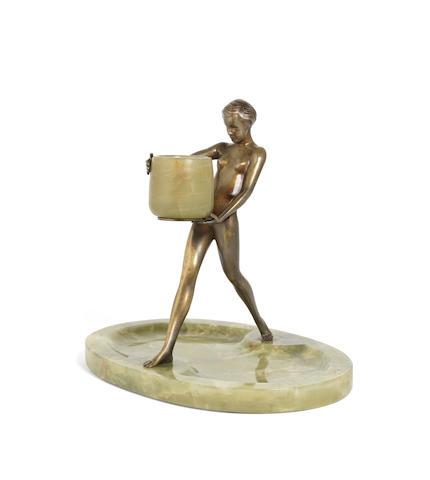 Josef Lorenzl (Austrian, 1892-1950) An Art Deco Patinated Bronze and Onyx Figural Match Holder, circa 1925