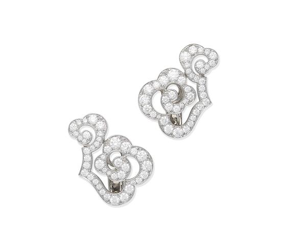 A pair of diamond earclips, by Cartier