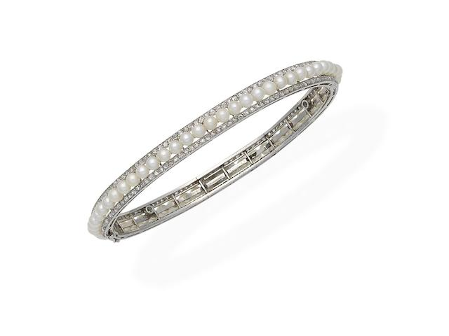 An early 20th century pearl and diamond bangle, by Georges Fouquet