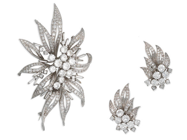 A diamond flower brooch and earring suite, circa 1960 (2)