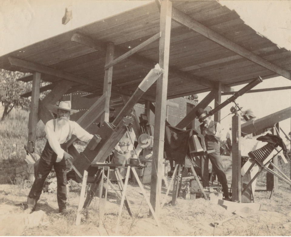 ASTRONOMY - B.A.S., ECLIPSE 1900, AND THE YERKES TELESCOPE Photograph album containing views relating to the British Astronomical Society expedition to view the total solar eclipse at Wadesborough, North Carolina in 1900, [1900]