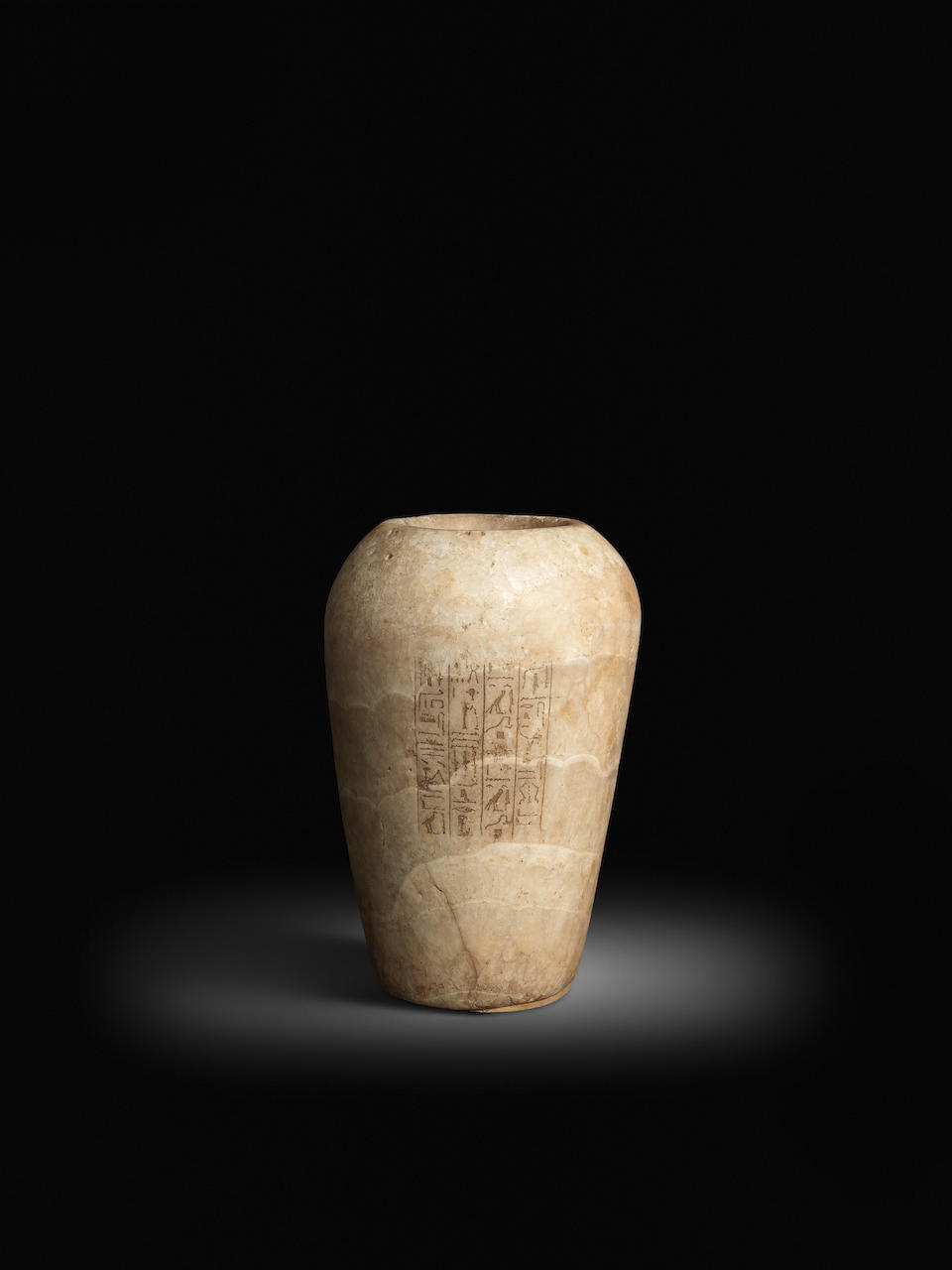 An Egyptian alabaster canopic jar for the royal scribe Semen-Tawy