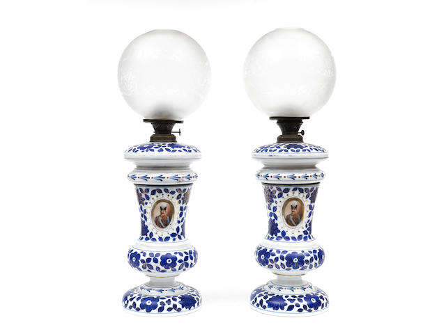 Two polychrome and gilt decorated opaline glass Lamps depicting Nasr al-Din Shah Qajar (reg. 1848-96) 19th Century(2)