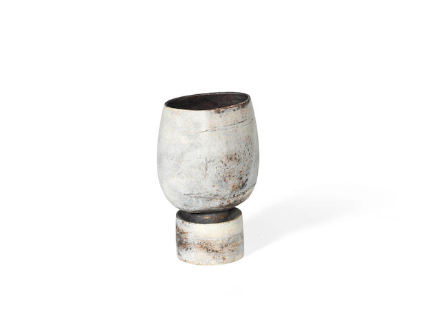 Hans Coper A Textured Stoneware Vase on Drum Base, circa 1972
