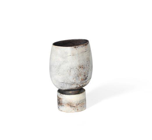 Hans Coper A Textured Stoneware Vase on Drum Base, circa 1972