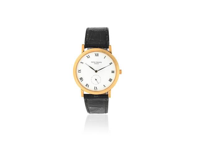 Patek Philippe. An 18K gold manual wind wristwatch  Calatrava, Ref: 3919, Manufactured 1999, Purchased 20th June 2000