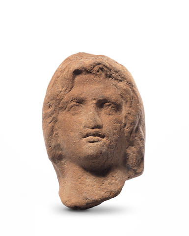 A Romano-Egyptian terracotta head of Alexander the Great