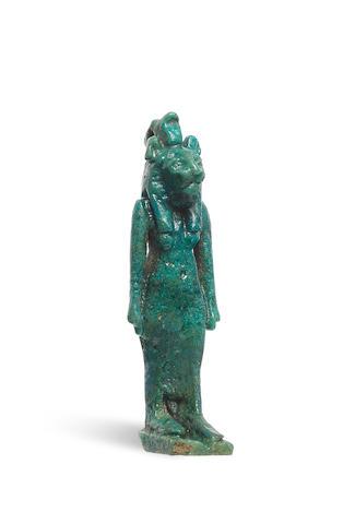 An Egyptian turquoise glazed composition amulet of Sekhmet