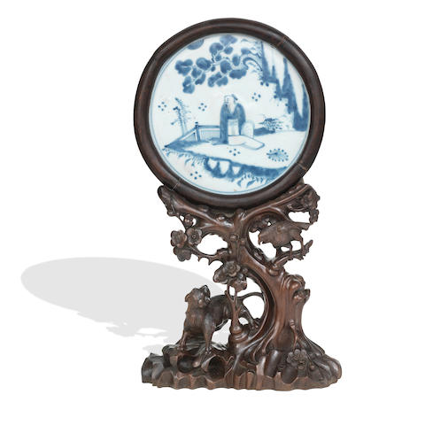 A blue and white porcelain plaque on hardwood stand The plaque Ming Dynasty, the stand 19th (2)