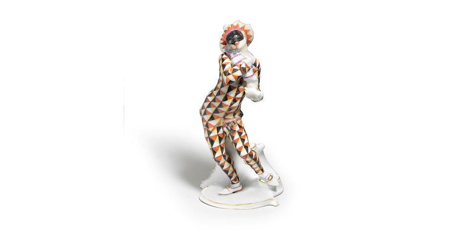 A Nymphenburg Commedia dell'Arte figure of Mezzetin dressed as a Harlequin, circa 1760-65