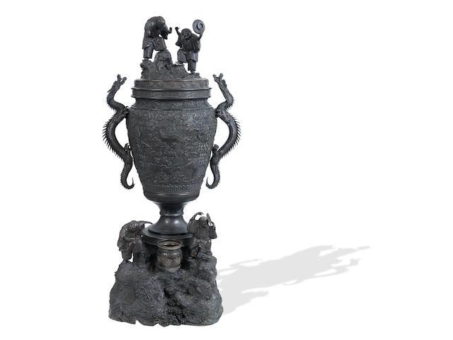 A massive bronze urn and cover By Hasegawa Harusada (1800-1883)