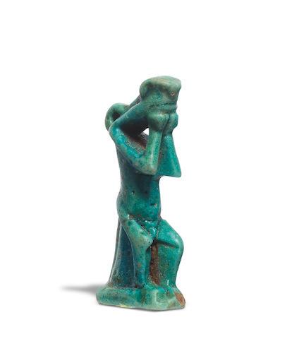 An Egyptian glazed composition amulet of Nehebkau