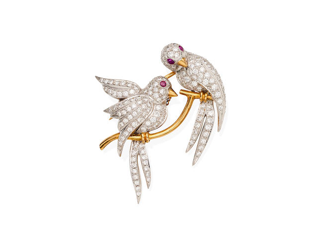 A diamond and ruby bird brooch