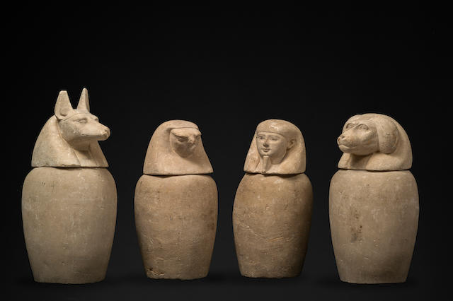 A set of four Egyptian limestone canopic jars