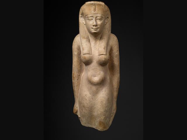 An Egyptian limestone figure of a Queen or goddess