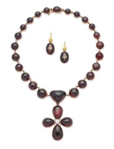 A mid-19th century garnet and diamond necklace and pendant suite and a pair of mid-19th century garnet and diamond earrings (3)