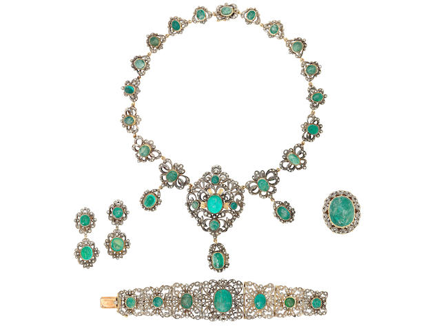 An emerald and diamond necklace, bracelet, pendent earring and ring suite, first half of the 20th century