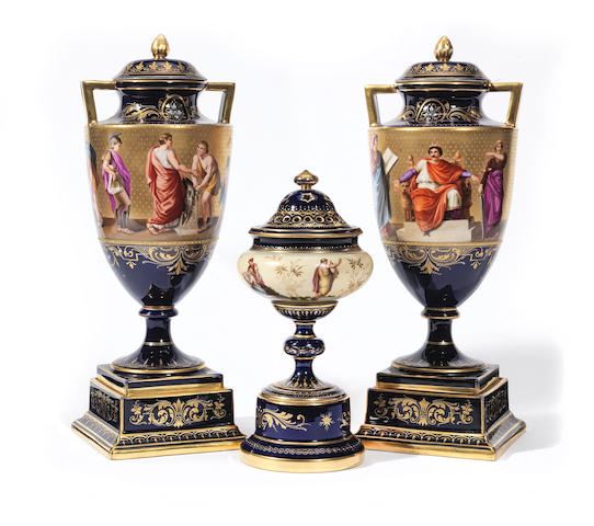 A pair of Vienna-style vases and covers and another Vienna-style vase and cover Circa 1900