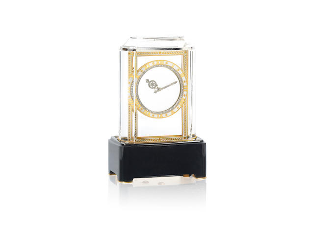 An art deco rock crystal, gold, agate, enamel and diamond-set 'Mystery Clock', by Cartier,