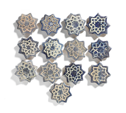 A group of Ilkhanid underglaze-painted pottery star tiles Persia, 14th Century(15)