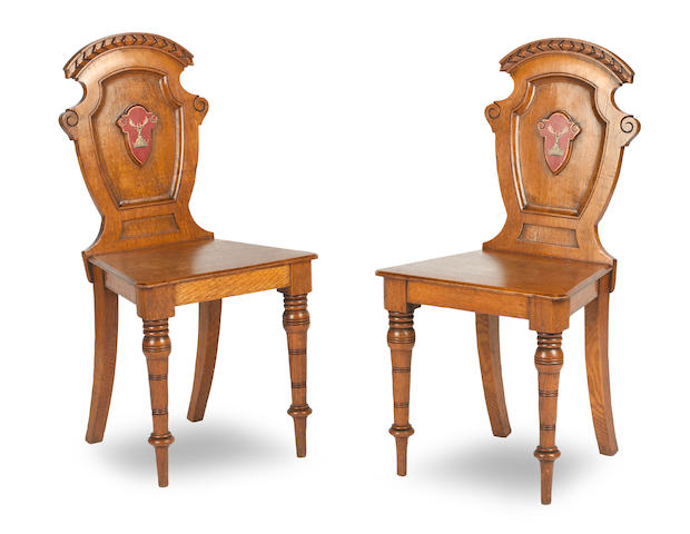A pair of 19th century oak hall chairs (2)
