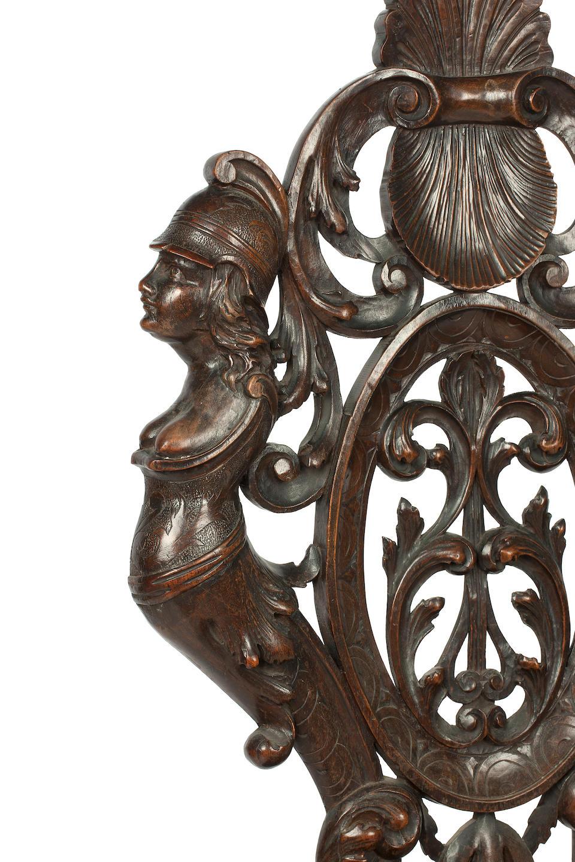 A 19th century Florentine carved walnut hall chair