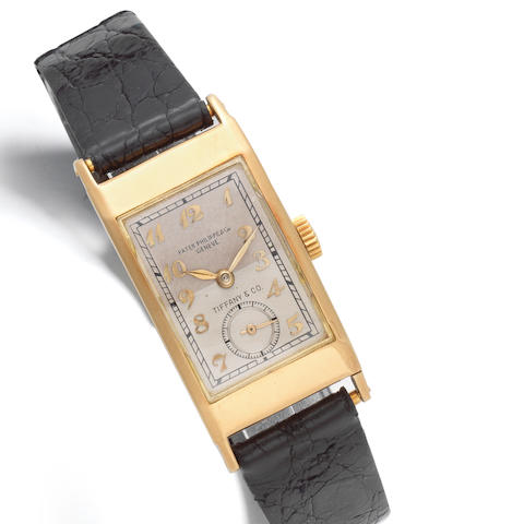 Patek, Philippe & Co, Geneve. A rare double signed 18K gold manual wind rectangular wristwatch retailed by Tiffany & Co.  Tegolino, Retailed by Tiffany & Co., Ref: 425, Sold 21st April 1941
