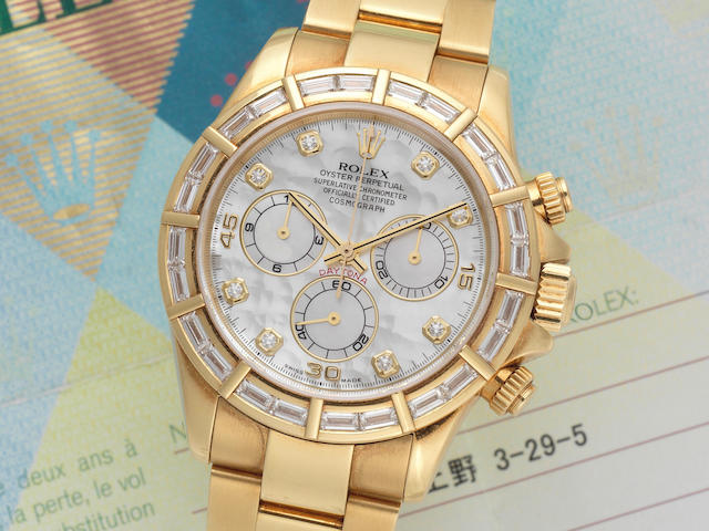 Rolex. An 18K gold and diamond set automatic chronograph bracelet watch with mother of pearl dial  Daytona, Ref: 116568, Circa 2000